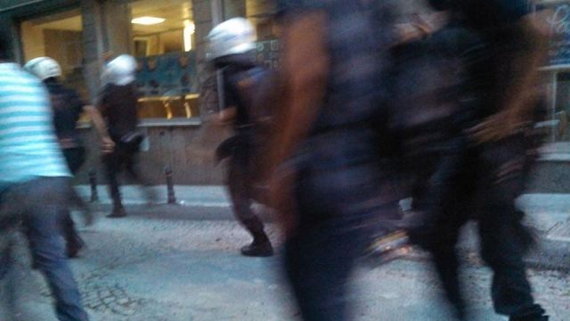 Cops chase, following tear gas volley