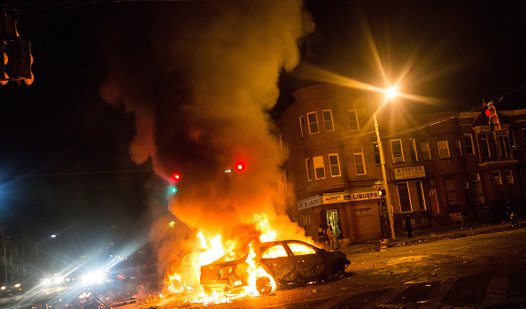 Two cars burn in the middle of an intersection at New Shiloh Baptist Church (Photo by Andrew Burton/Getty Images) Source: http://baltimore.cbslocal.com/2015/04/28/fires-still-burning-across-baltimore/